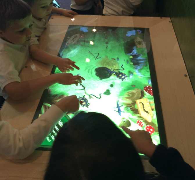 Kids playing on a virtual game table